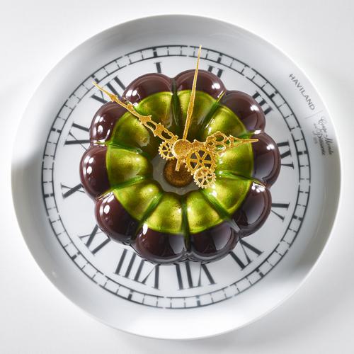 Coupe du Monde de la Patisserie dessert plate. Entremets Cake with Clockwork theme